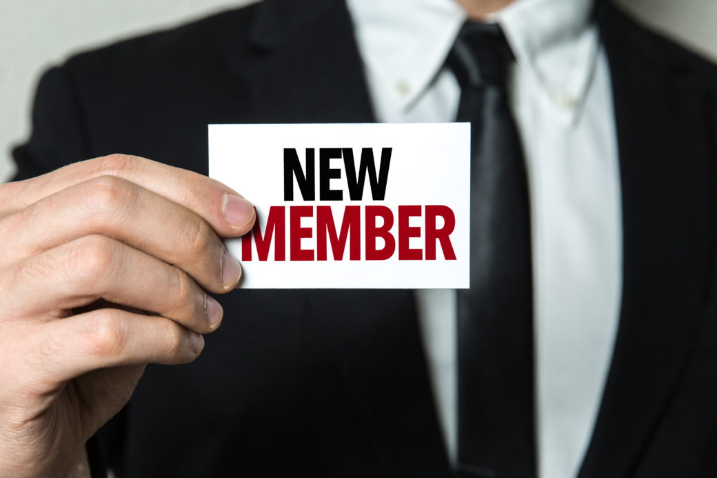 Man Holding New Member Card
