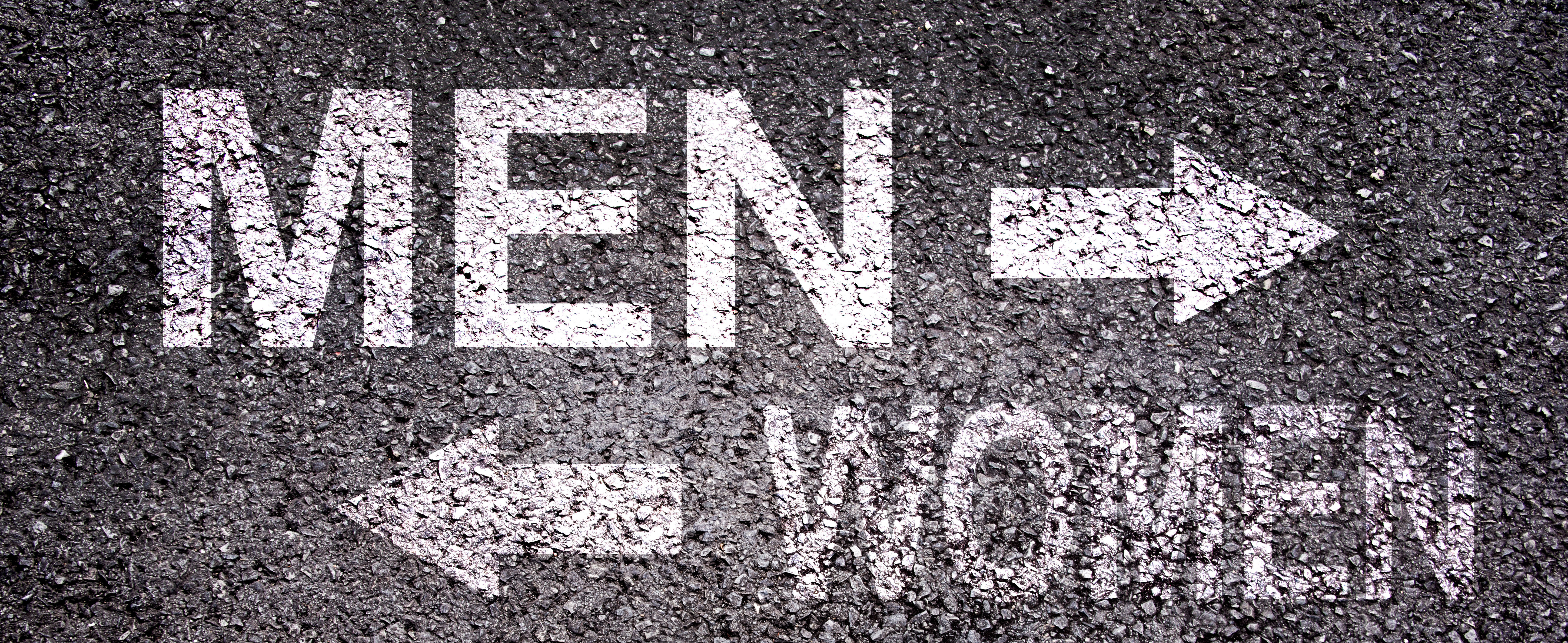 Picture of Asphalt with 'Men' and 'Women' sprayed into the ground with opposing arrows